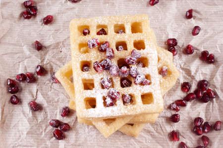 powdered sugar: waffle with pomegranate seed and powdered sugar Stock Photo