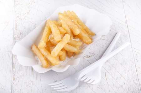 paperboard: french fries, white paperboard container and plastic fork Stock Photo