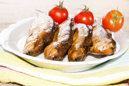 whitefish: hot smoked whitefish and tomato on a plate Stock Photo