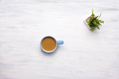 break from work: Top view of cup of coffee on a white wooden table. Break from work, lifestyle concept. Stock Photo