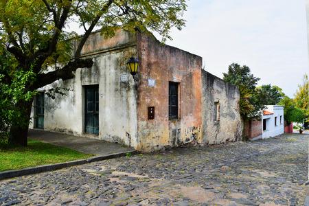 colonia del sacramento: Historic traditional houses and cobblestone street in old town of Colonia Del Sacramento, Uruguay.