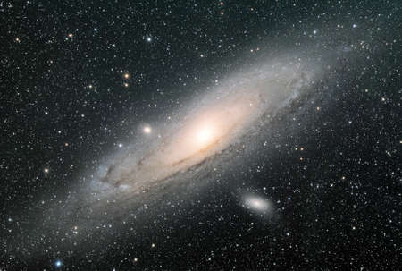andromeda: A spiral galaxy approximately 2 5 million light-years from Earth in the Andromeda constellation  Also known as Messier 31, the Andromeda Galaxy is the largest galaxy of the Local Group of galaxies  Stock Photo