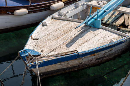 prow: Detail on the prow of an old, small, and very worn traditional croatian fishing boat. Stock Photo