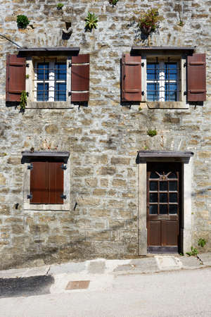 front house: Front view of a traditional mediterranean residential stone house
