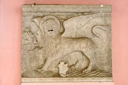 winged lion: Stone bas-relief of a venetian winged lion from the croatian town of Oprtalj (Portole) in Istria.
