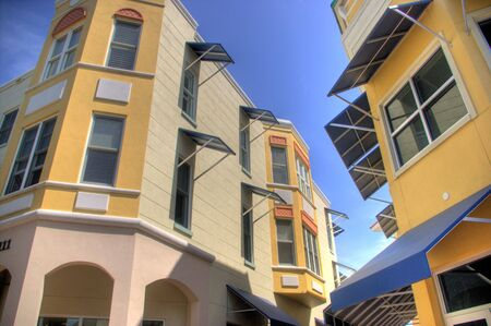 awnings: Lakewood Ranch, Florida, has a mainstreet section in the style of turn-of-the-century smalltown USA, with luxury condo above the shops.  However, there awning treatment is very modern.   Stock Photo
