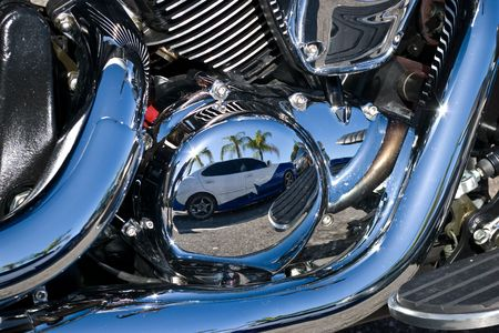 Reflection of custom painted car in motorcycles chrome motor parts