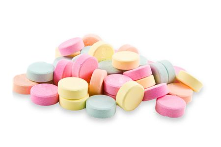 A pile of colorful, geneic antacid tablets.