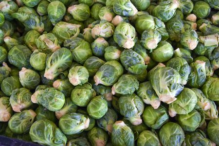 brussel: A bin full of fresh brussel sprouts at a local farmers market