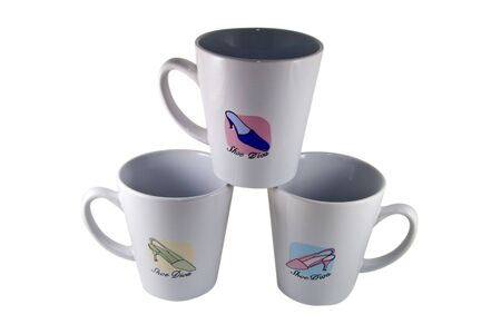 Coffee mugs decorated with womens shoes. Imagens