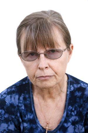 head on shoulder: Stern looking female senior head & shoulder shot wwhite background Stock Photo