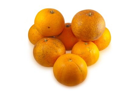 peal: Pile of real oranges, fresh from tree with normal scares and defects.  Isolated on white background with clipping paths. Stock Photo