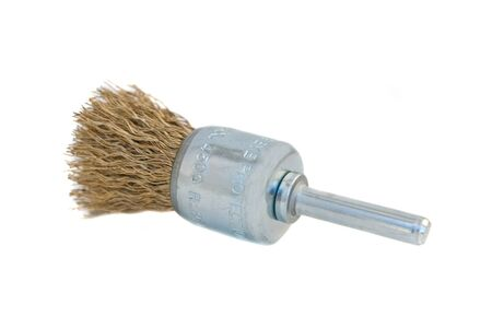 Rotary brass wire brush attachment for a hand drill, isolated on white background.