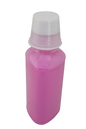 Bottle of pink bismo for stomac, isolated with clipping path.