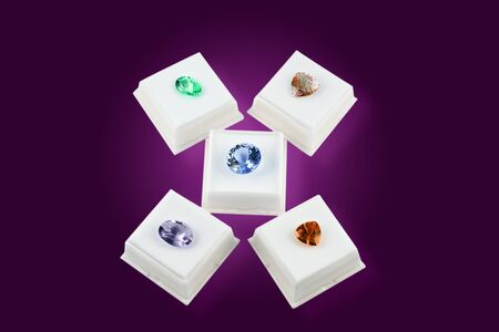 gem stones: Various colors of faceted gem stones, in white boxes Stock Photo