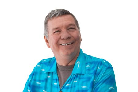 graying: Portrait of a smiling 57 year old senior man wearing a bright blue shirt, isolated on white background. Stock Photo