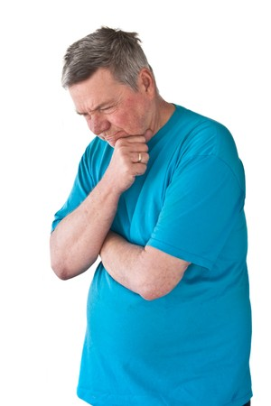 3/4 view of a distraught mature man, looking downwad in hopeless disgust, isolated on white background. Stock Photo - 4375081