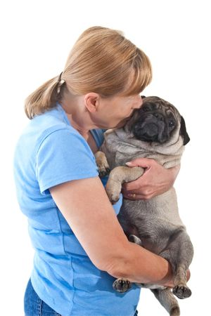 smooching: Mature Lady Cuddling a Pug Dog, Isolated on a White Background