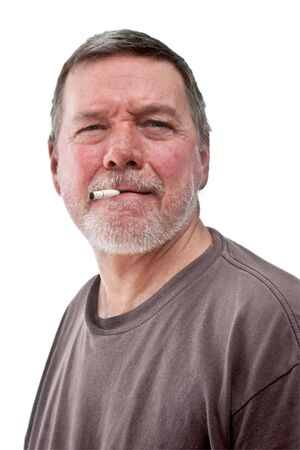 unkept: Headshot of mature homeless man with cigarette butt, scruffy beard and t-shirt.  Isolated on white