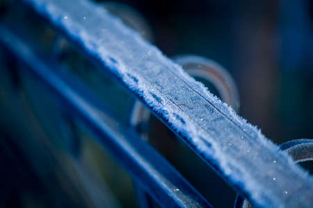 Iron railing covered with morning frost