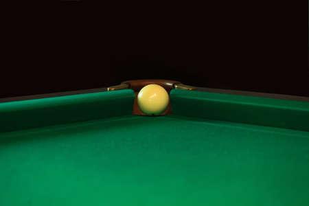 Playing billiard. Billiards balls and cue on green billiards table. Billiard sport concept. Pool billiard game. Russian pyramid (Russian billiard, pyramid billiards), cue sport.