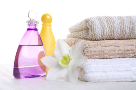 hygienic still-life, aromatic oil, shampoo and towel, aromatic therapy