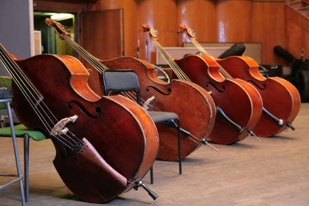 Vintage, music instruments, four old bass viols Stock Photo