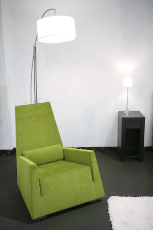 fragment of the interior with green easy-chair and floor-lamp Stock Photo - 2817191