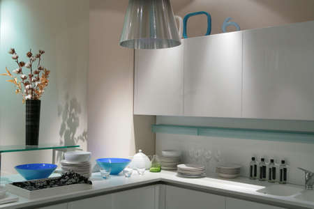 interior of modern kitchen in light tone with bouquet of �otton bud