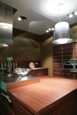 interior to modern kitchen in brown tone