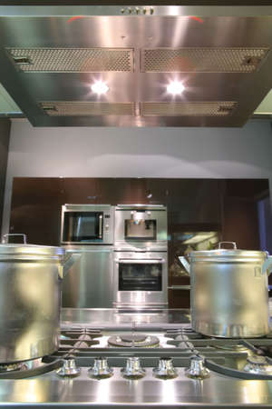 fragment of interiors of modern kitchen with gas fryer
