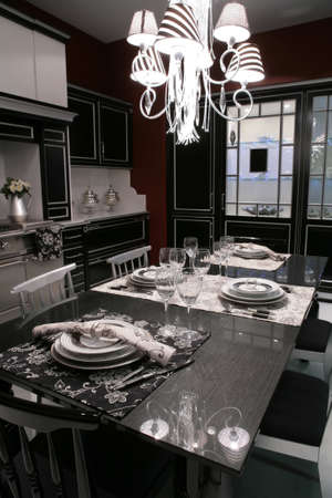 interior of modern dinning-room in monochrome style with served table