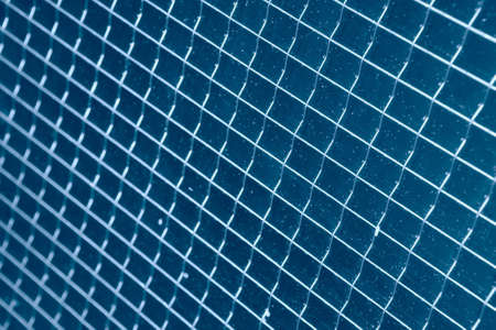 briliance: abstraction, rhythm, net from fine metallic wire in glass Stock Photo