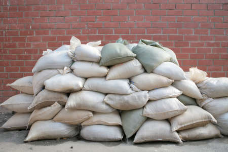 background, pervaded bags, liing stack near by brick wall