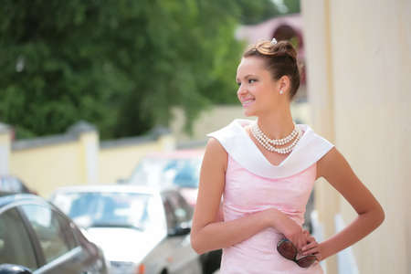 splendid: smiling girl with pearl necklace and sunglasses, with copy-space Stock Photo