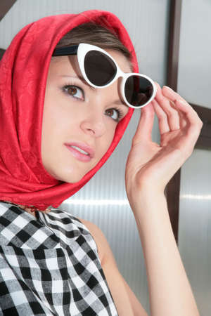 young womanl in plaid dress with red kerchief and stylish sunglasses photo