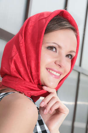 smiling young beautiful woman in red kerchief photo