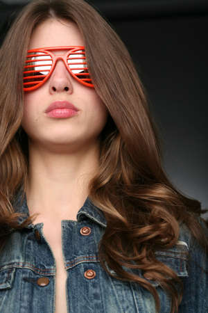 splendid: portrait of the girl in red sunglasses