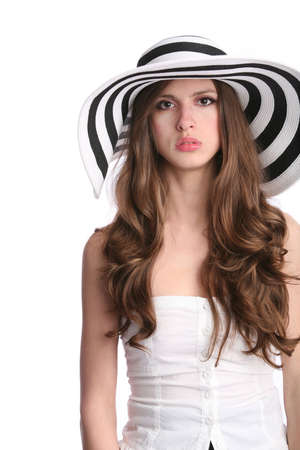 sad beautiful girl in striped hat on the white background photo