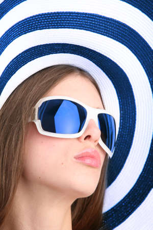 portrait of the beautiful girl in sunglasses and striped hat Stock Photo