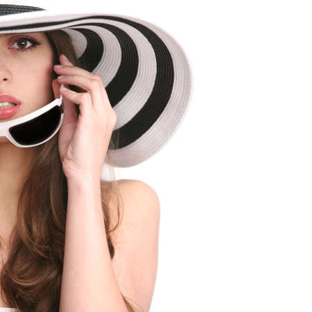 beautiful girl in striped hat and sunglasses on the white background photo