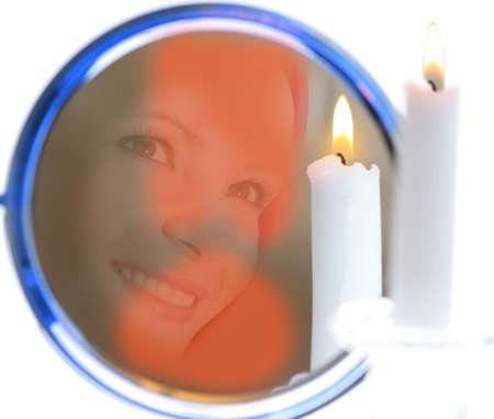 mirror, candle and reflection of the girl face photo