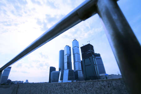 banisters: evening type of skyscrapers of the Moscow from under quay banisters