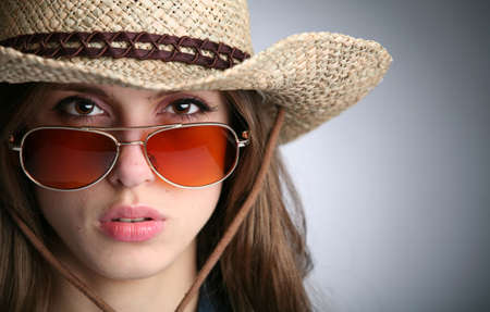 horizontal portrait of the girl in hat and sunglasses photo