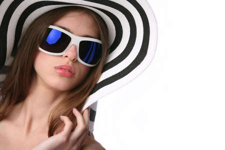 luxury girl in striped hat and sunglasses photo