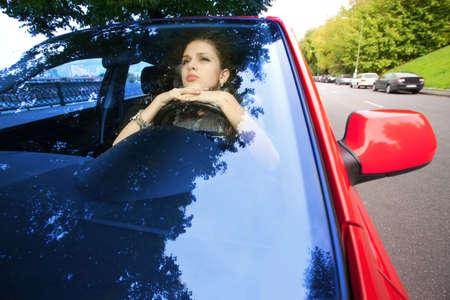 inwardly: beautiful woman dreaming inwardly of car