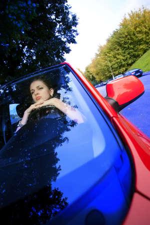 beautiful woman in red car dreams of future Stock Photo