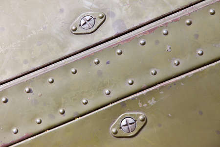 old  metal surfaces with rivets photo