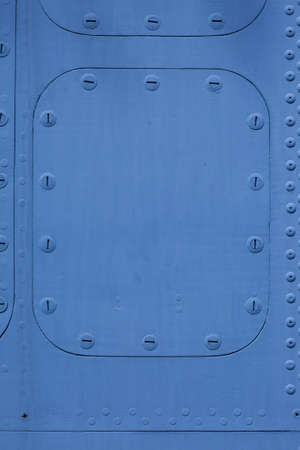blue metal surface with a hatch on the bolt photo