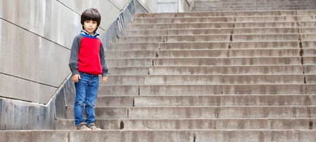 boy stood on the stairs and looks back Stock Photo - 16991138